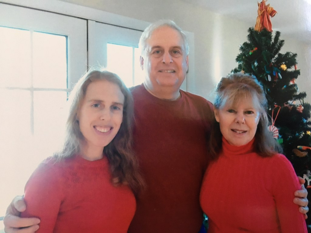 This image has an empty alt attribute; its file name is Christmas-with-Mom-and-Dad.jpg
